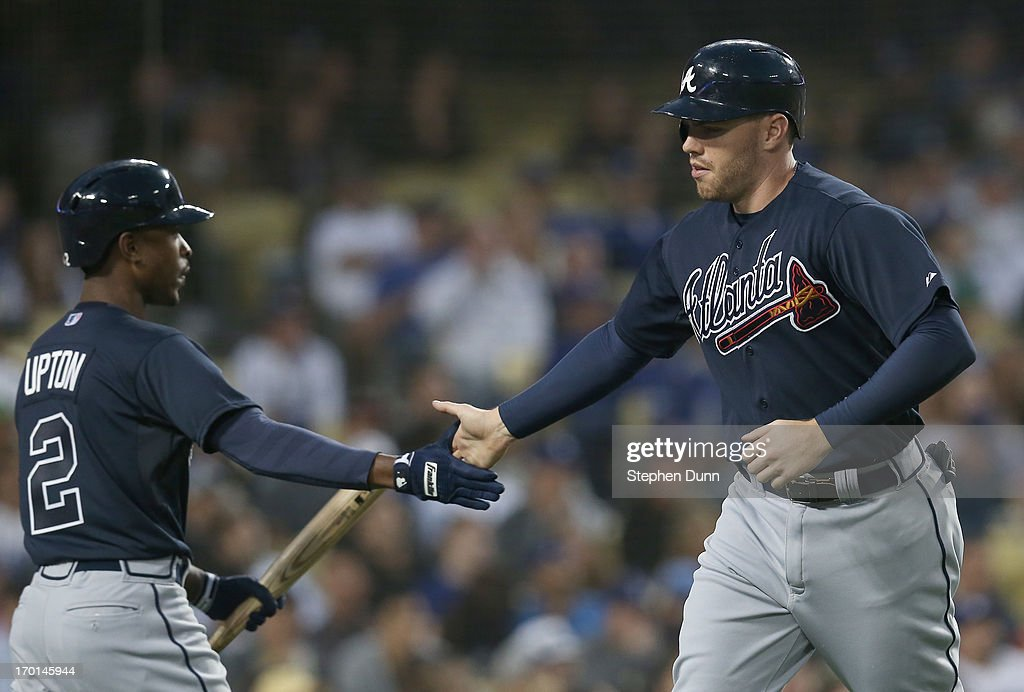 <a gi-track='captionPersonalityLinkClicked' href=/galleries/search?phrase=Freddie+Freeman&family=editorial&specificpeople=5743987 ng-click='$event.stopPropagation()'>Freddie Freeman</a> #5 of the Atlanta Braves is greeted by <a gi-track='captionPersonalityLinkClicked' href=/galleries/search?phrase=B.J.+Upton&family=editorial&specificpeople=810704 ng-click='$event.stopPropagation()'>B.J. Upton</a> #2 after scoring a run in the fourth inning against the Los Angeles Dodgers at Dodger Stadium on June 7, 2013 in Los Angeles, California.