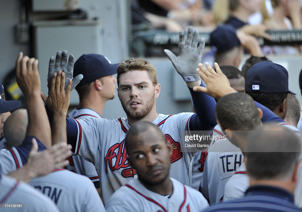 <a gi-track='captionPersonalityLinkClicked' href=/galleries/search?phrase=Freddie+Freeman&family=editorial&specificpeople=5743987 ng-click='$event.stopPropagation()'>Freddie Freeman</a> #5 of the Atlanta Braves is greeted by his teammates and coaches after hitting a two-run homer against the Chicago White Sox during the eighth inning on July 20, 2013 at U.S. Cellular Field in Chicago, Illinois. The Chicago White Sox defeated the Atlanta Braves 10-6.