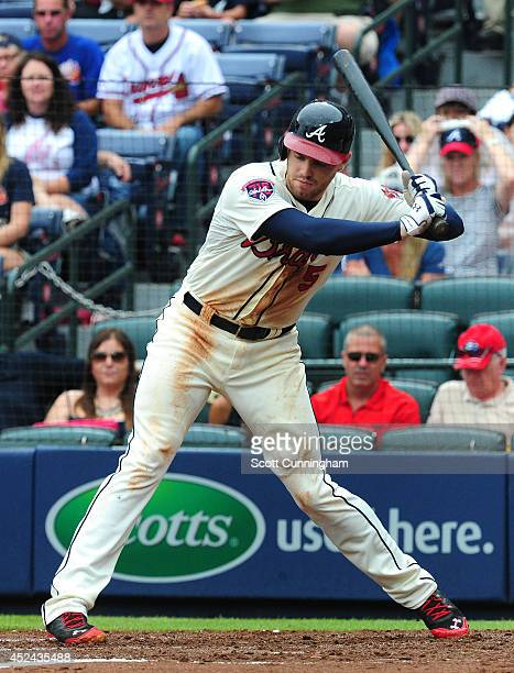 Freddie Freeman of the Atlanta Braves is hit by a pitch just above the left knee during the third inning against the Philadelphia Phillies at Turner...