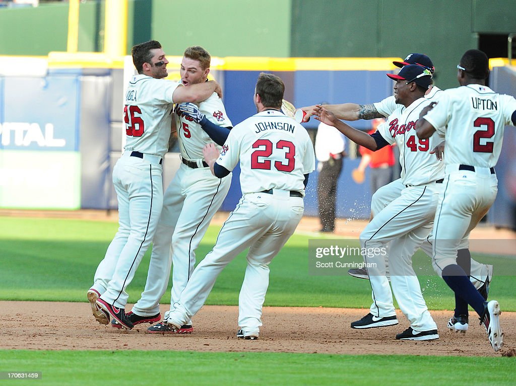 <a gi-track='captionPersonalityLinkClicked' href=/galleries/search?phrase=Freddie+Freeman&family=editorial&specificpeople=5743987 ng-click='$event.stopPropagation()'>Freddie Freeman</a> #5 of the Atlanta Braves is mobbed by teammates after knocking in the game-winning run in the ninth inning against the San Francisco Giants at Turner Field on June 15, 2013 in Atlanta, Georgia.