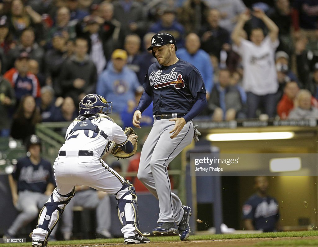 <a gi-track='captionPersonalityLinkClicked' href=/galleries/search?phrase=Freddie+Freeman&family=editorial&specificpeople=5743987 ng-click='$event.stopPropagation()'>Freddie Freeman</a> #5 of the Atlanta Braves is tagged out at homeplate by <a gi-track='captionPersonalityLinkClicked' href=/galleries/search?phrase=Jonathan+Lucroy&family=editorial&specificpeople=5732413 ng-click='$event.stopPropagation()'>Jonathan Lucroy</a> #20 of the Milwaukee Brewers in the fourth inning of a game at Miller Park on April 1, 2014 in Milwaukee, Wisconsin.