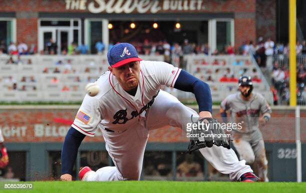 Freddie Freeman of the Atlanta Braves is unable to make a play at third base against the Houston Astros during the second inning at SunTrust Park on...