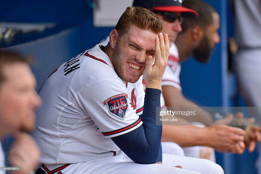 Freddie Freeman #5 of the Atlanta Braves laughs with teammates in the dugout during the eighth inning against the Philadelphia Phillies at Turner Field on June 18, 2014 in Atlanta, Georgia.