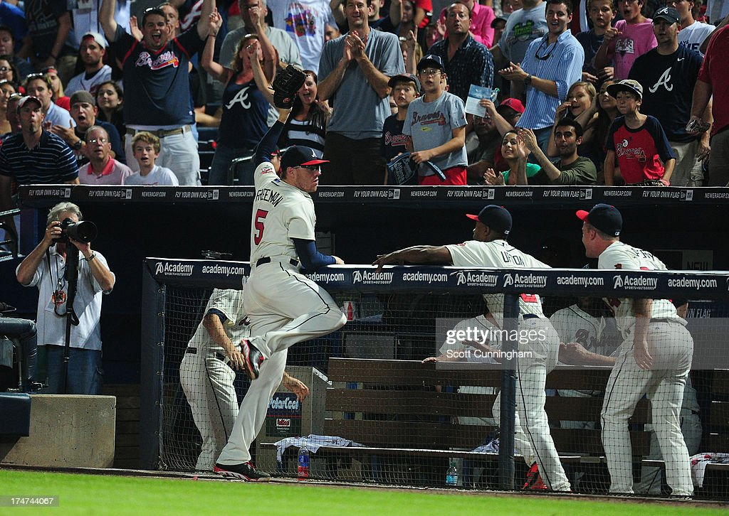 <a gi-track='captionPersonalityLinkClicked' href=/galleries/search?phrase=Freddie+Freeman&family=editorial&specificpeople=5743987 ng-click='$event.stopPropagation()'>Freddie Freeman</a> #5 of the Atlanta Braves makes a catch of a foul fly over the railing against the St. Louis Cardinals at Turner Field on July 28, 2013 in Atlanta, Georgia.