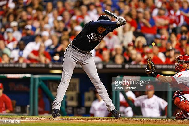 Freddie Freeman of the Atlanta Braves moves out of the way of an inside pitch in the third inning of the game against the Philadelphia Phillies at...