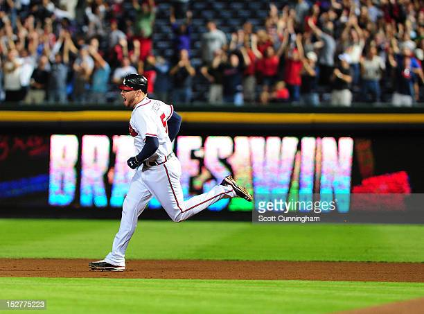 Freddie Freeman of the Atlanta Braves rounds the bases after hitting a 9th inning walk off home run against the Miami Marlins at Turner Field on...