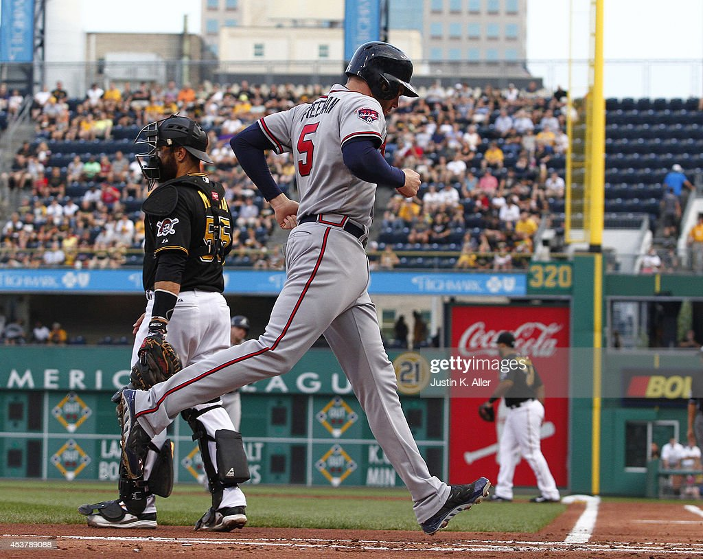 <a gi-track='captionPersonalityLinkClicked' href=/galleries/search?phrase=Freddie+Freeman&family=editorial&specificpeople=5743987 ng-click='$event.stopPropagation()'>Freddie Freeman</a> #5 of the Atlanta Braves scores on a infield single in the first inning against the Pittsburgh Pirates during the game at PNC Park on August 18, 2014 in Pittsburgh, Pennsylvania.