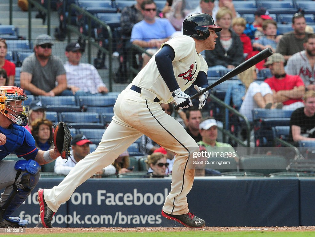 <a gi-track='captionPersonalityLinkClicked' href=/galleries/search?phrase=Freddie+Freeman&family=editorial&specificpeople=5743987 ng-click='$event.stopPropagation()'>Freddie Freeman</a> #5 of the Atlanta Braves singles against the New York Mets at Turner Field on May 5, 2013 in Atlanta, Georgia.