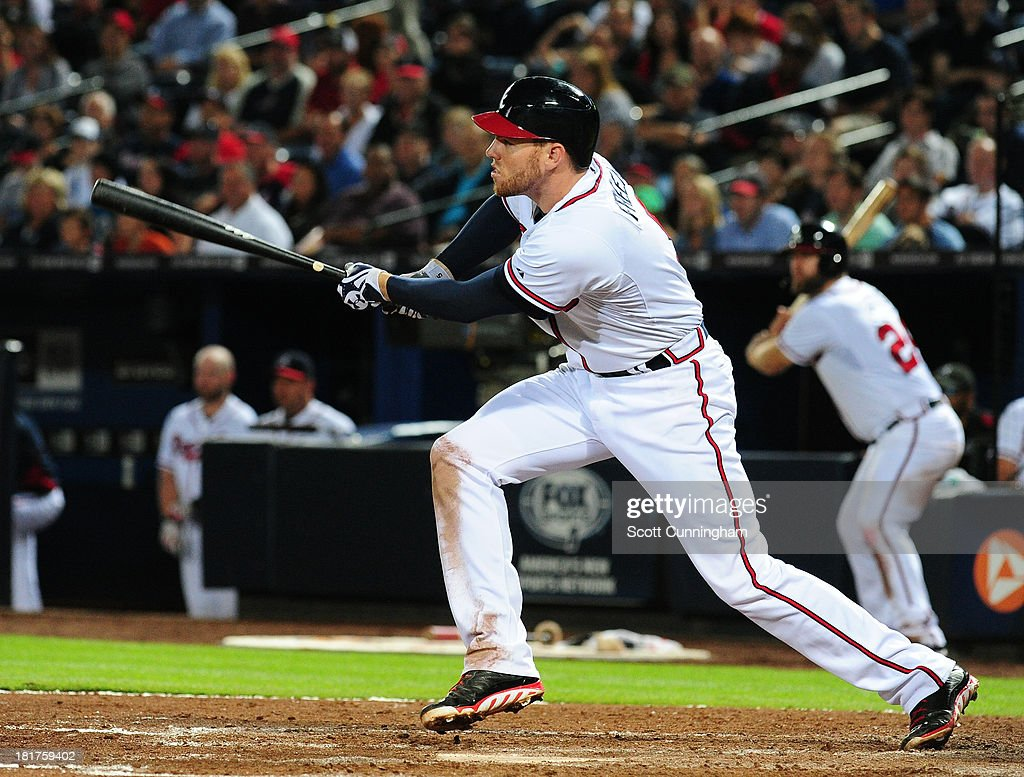 <a gi-track='captionPersonalityLinkClicked' href=/galleries/search?phrase=Freddie+Freeman&family=editorial&specificpeople=5743987 ng-click='$event.stopPropagation()'>Freddie Freeman</a> #5 of the Atlanta Braves singles to knock in a sixth inning run against the Milwaukee Brewers at Turner Field on September 24, 2013 in Atlanta, Georgia.