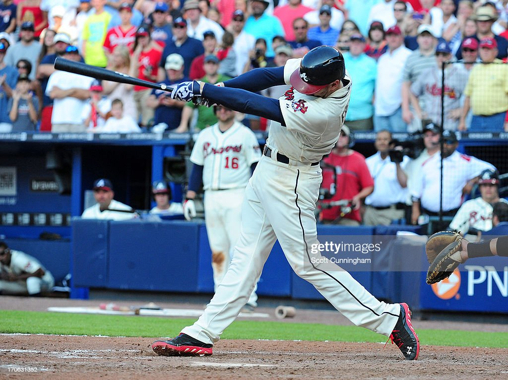 <a gi-track='captionPersonalityLinkClicked' href=/galleries/search?phrase=Freddie+Freeman&family=editorial&specificpeople=5743987 ng-click='$event.stopPropagation()'>Freddie Freeman</a> #5 of the Atlanta Braves singles to knock in the game-winning run in the ninth inning against the San Francisco Giants at Turner Field on June 15, 2013 in Atlanta, Georgia.