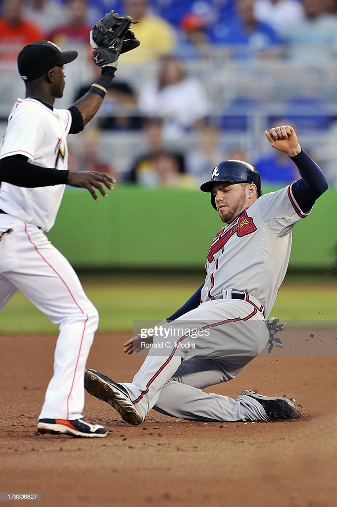 Freddie Freeman #5 of the Atlanta Braves slides during a MLB game against the Miami Marlins at Marlins Park on July 8, 2013 in Miami, Florida.