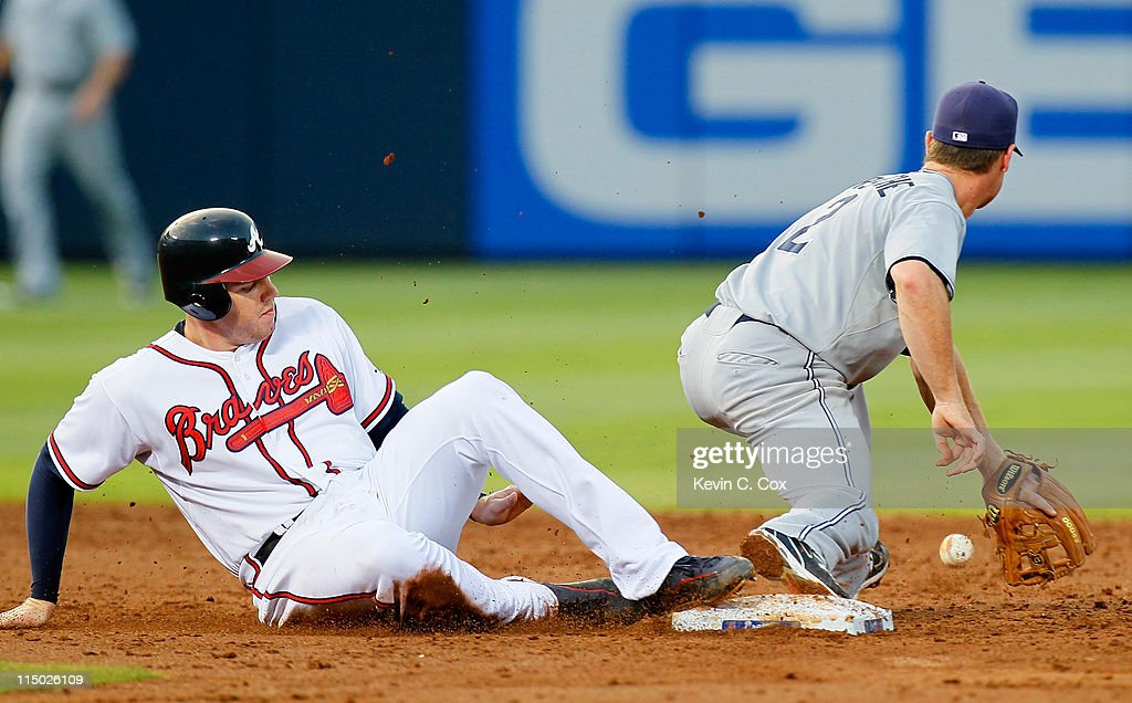 <a gi-track='captionPersonalityLinkClicked' href=/galleries/search?phrase=Freddie+Freeman&family=editorial&specificpeople=5743987 ng-click='$event.stopPropagation()'>Freddie Freeman</a> #5 of the Atlanta Braves slides safely back into second base after a deep fly out thrown back in to Logan Forsythe #12 of the San Diego Padres at Turner Field on June 1, 2011 in Atlanta, Georgia.