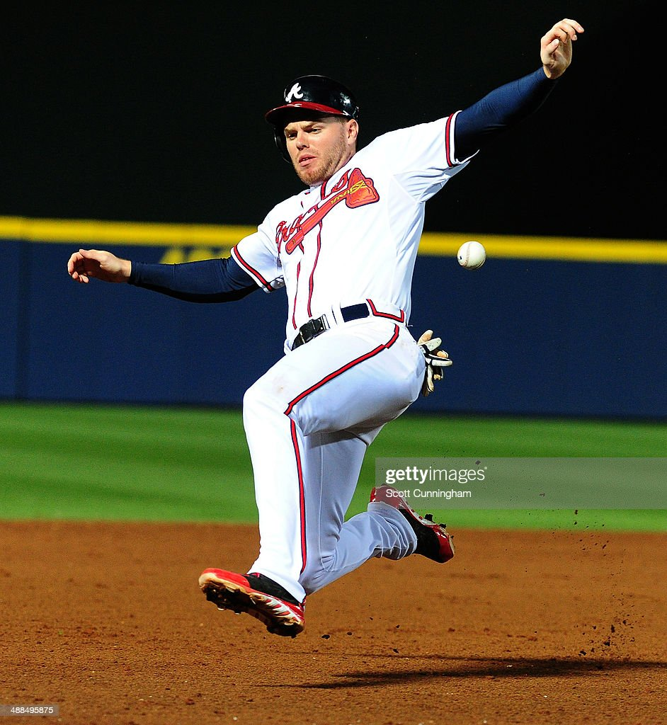 <a gi-track='captionPersonalityLinkClicked' href=/galleries/search?phrase=Freddie+Freeman&family=editorial&specificpeople=5743987 ng-click='$event.stopPropagation()'>Freddie Freeman</a> #5 of the Atlanta Braves slides safely in to third base during the 8th inning against the St. Louis Cardinals at Turner Field on May 6, 2014 in Atlanta, Georgia.