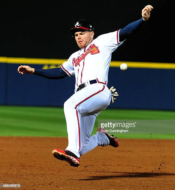 Freddie Freeman of the Atlanta Braves slides safely in to third base during the 8th inning against the St Louis Cardinals at Turner Field on May 6...