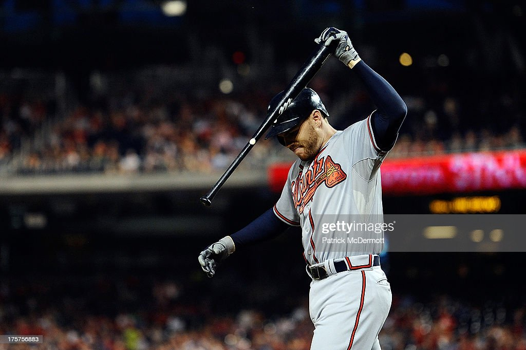 <a gi-track='captionPersonalityLinkClicked' href=/galleries/search?phrase=Freddie+Freeman&family=editorial&specificpeople=5743987 ng-click='$event.stopPropagation()'>Freddie Freeman</a> #5 of the Atlanta Braves throws his bat after striking out in the fourth inning during a game against the Washington Nationals at Nationals Park on August 7, 2013 in Washington, DC.