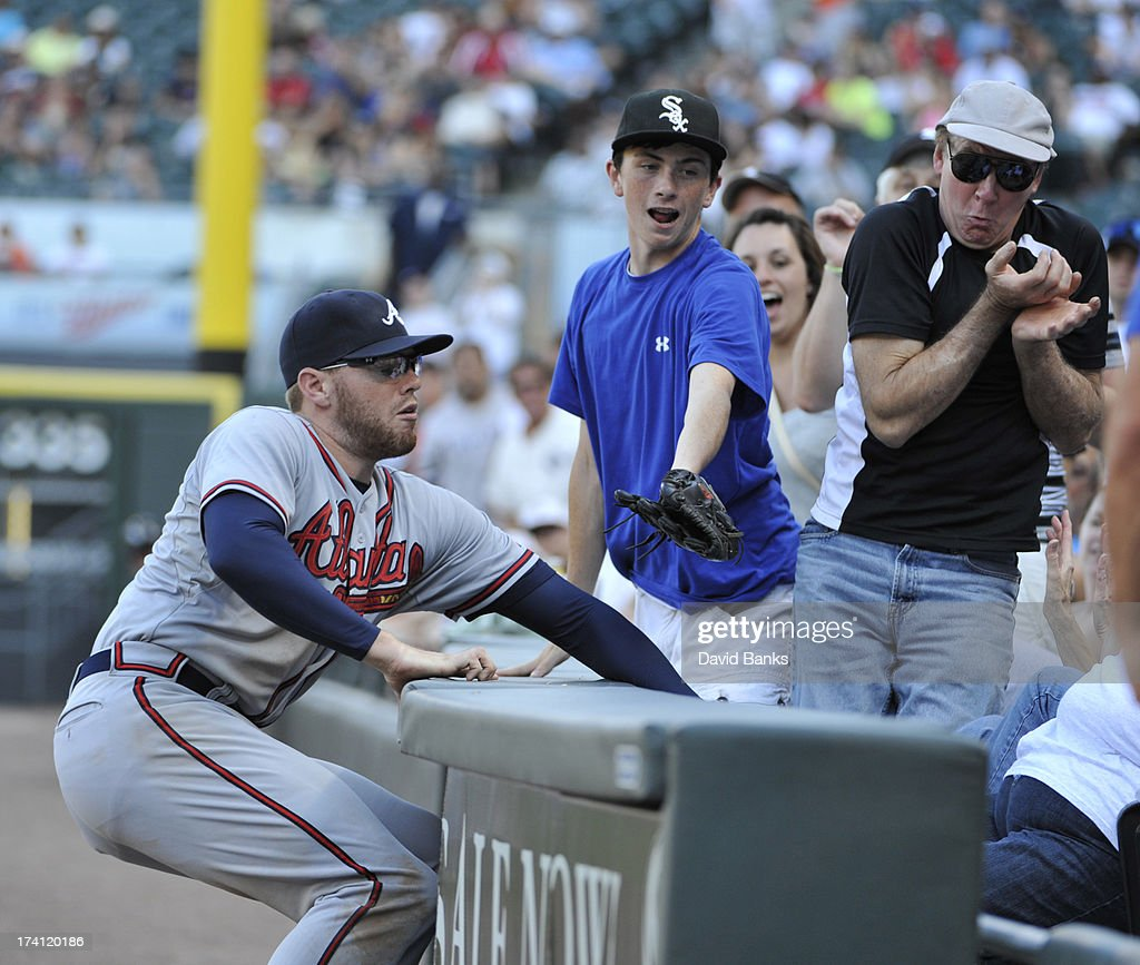 Freddie Freeman #5 of the Atlanta Braves tries to catch a foul ball against the Chicago White Sox during the eighth inning on July 20, 2013 at U.S. Cellular Field in Chicago, Illinois. The Chicago White Sox defeated the Atlanta Braves 10-6.