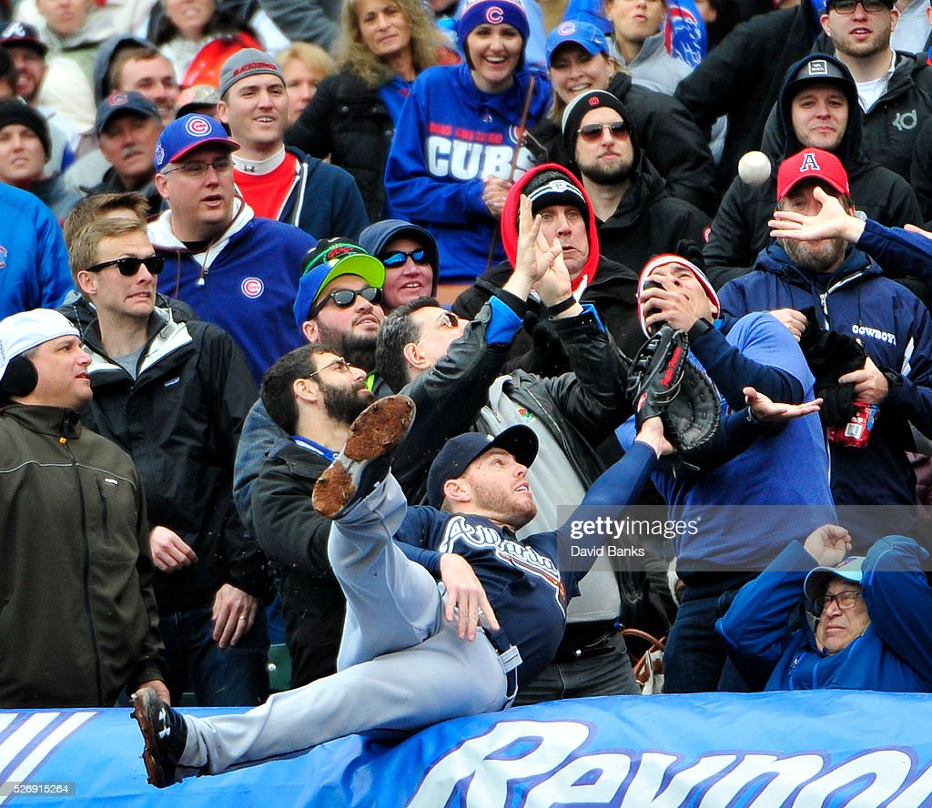 Freddie Freeman #5 of the Atlanta Braves tries to make a catch on a foul ball hit by John Lackey #41 of the Chicago Cubs during the fifth inning on May 1, 2016 at Wrigley Field in Chicago, Illinois.