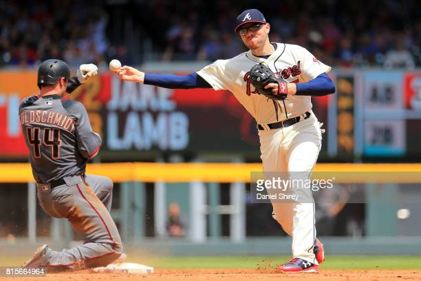 Freddie Freeman of the Atlanta Braves turns a double play over Paul Goldschmidt of the Arizona Diamondbacks during the sixth inning at SunTrust Park...