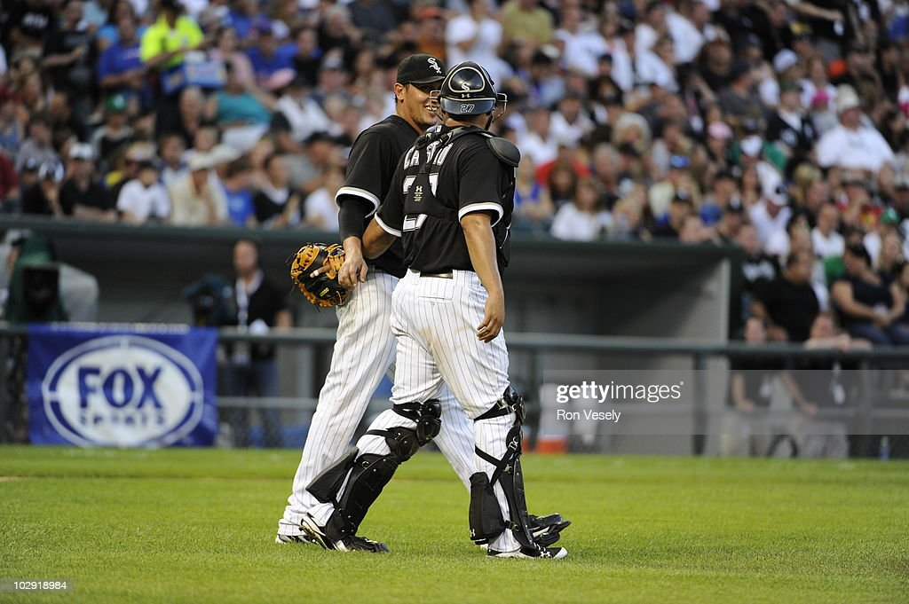 Freddie Garcia #34 smiles while talking to catcher Ramon Castro #27 of the Chicago White Sox during the game against the Chicago Cubs on June 26, 2010 at U.S. Cellular Field in Chicago, Illinois. The White Sox defeated the Cubs 3-2.
