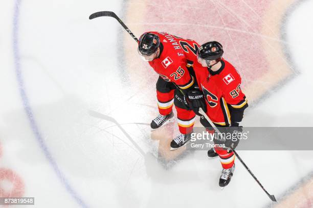 Freddie Hamilton and Sam Bennett of the Calgary Flames chat at warm up in an NHL game against the St Louis Blues at the Scotiabank Saddledome on...