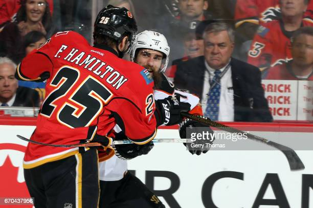 Freddie Hamilton of the Calgary Flames checks Patrick Eaves of the Anaheim Ducks during Game Four of the Western Conference First Round during the...
