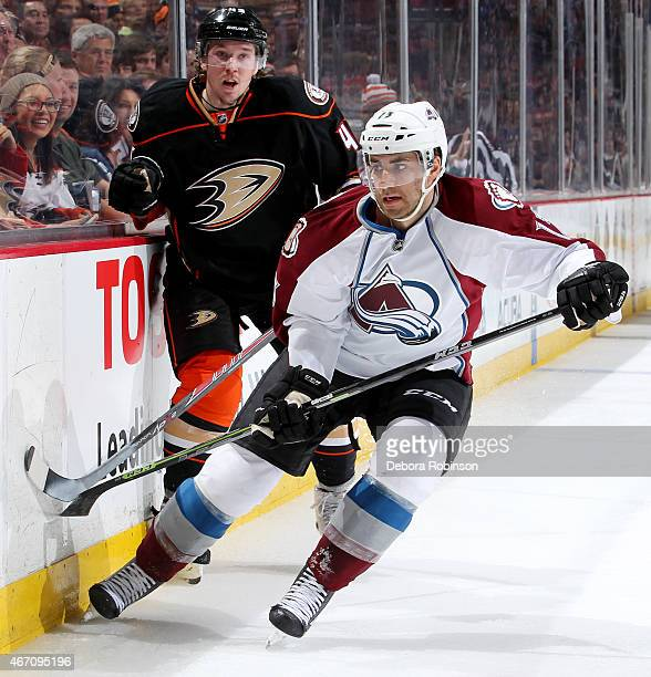 Freddie Hamilton of the Colorado Avalanche handles the puck against Sami Vatanen of the Anaheim Ducks on March 20 2015 at Honda Center in Anaheim...