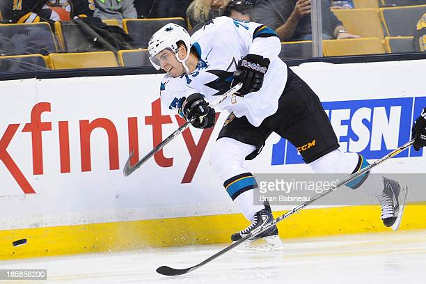 Freddie Hamilton of the San Jose Sharks shoots the puck against the Boston Bruins at the TD Garden on October 24 2013 in Boston Massachusetts