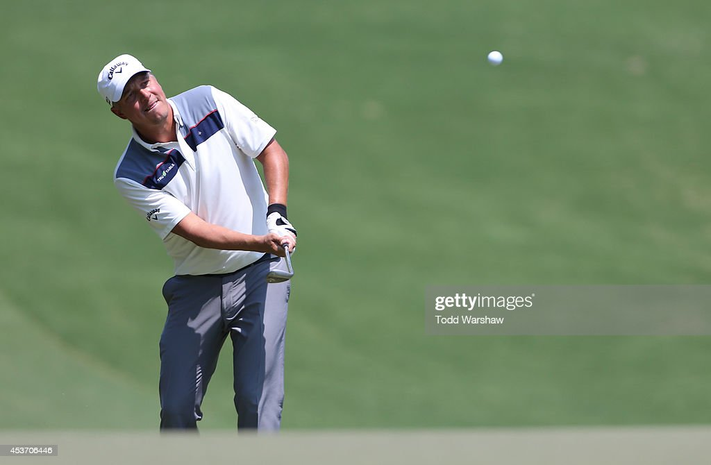 Freddie Jacobson of Sweden chips onto the green on the first hole during the third round of the Wyndham Championship at Sedgefield Country Club on August 16, 2014 in Greensboro, North Carolina.