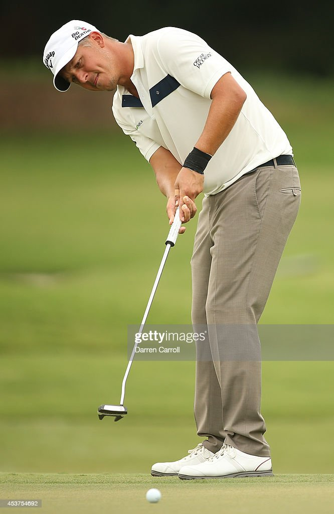 Freddie Jacobson of Sweden putts on the 10th hole during the final round of the Wyndham Championship at Sedgefield Country Club on August 17, 2014 in Greensboro, North Carolina.