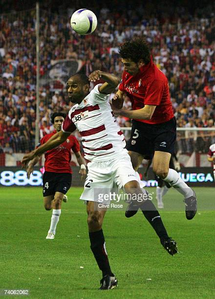 Freddie Kanoute of Sevilla is challenged by Carlos Cuellar of Osasuna during the UEFA Cup semi final secondleg match between Sevilla and Osasuna at...