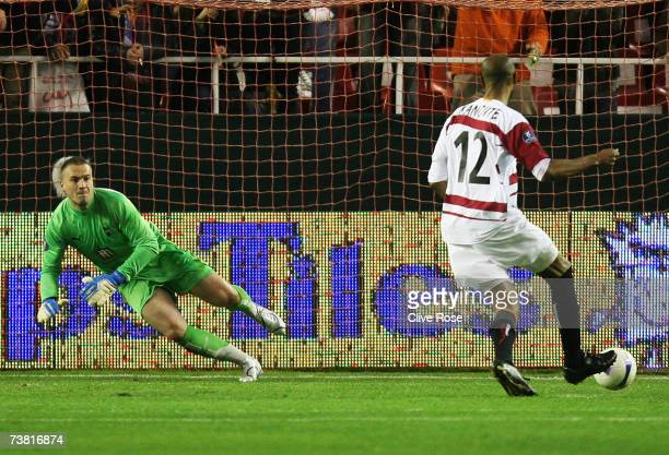 Freddie Kanoute of Sevilla scores a penalty past Paul Robinson of Tottenham Hotspur during their UEFA Cup quarter final match between Sevilla and...