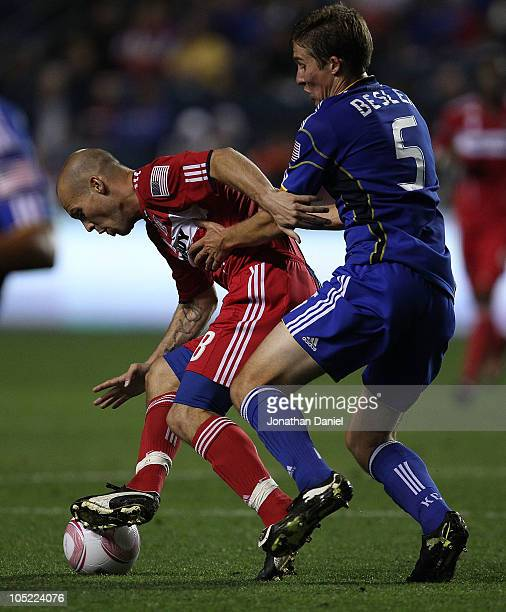Freddie Ljungberg of the Chicago Fire is held by Matt Besler of the Kansas City Wizards in an MLS match on October 12 2010 at Toyota Park in...