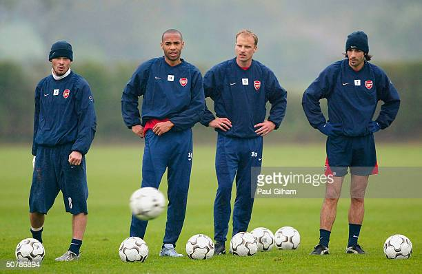 Freddie Ljungberg Thierry Henry Dennis Bergkamp and Robert Pires line up to practise free kicks during the Arsenal Football Club training session at...