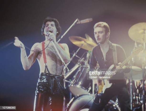 Freddie Mercury and John Deacon of Queen perform on stage at Ahoy on 29th January 1979 in Rotterdam Netherlands