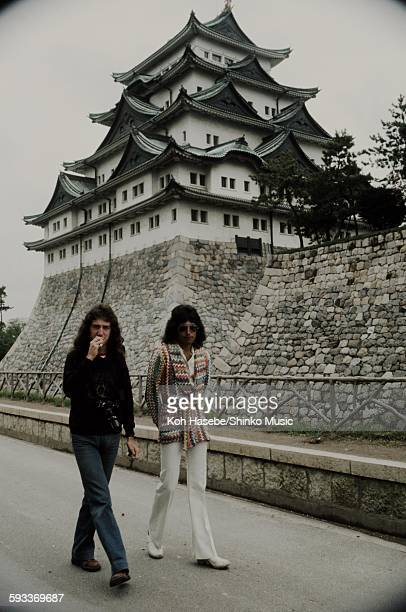 Freddie Mercury and John Deacon walking in front of Nagoya Castle Nagoya April 22 1975