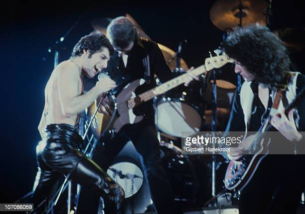 Freddie Mercury John Deacon and Brian May of Queen perform on stage at Ahoy on 29th January 1979 in Rotterdam Netherlands