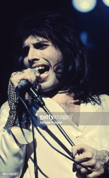 Freddie Mercury of British rock band Queen in concert 1974
