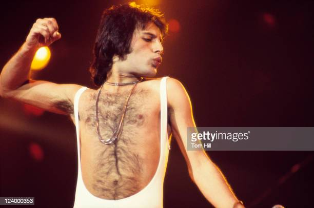 Freddie Mercury of Queen performing at the Omni