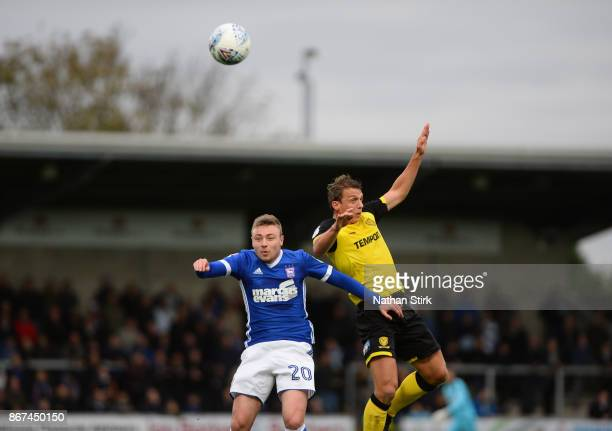 Freddie Sears of Ipswich and Stephen Warnock of Burton Albion compete for the ball during the Sky Bet Championship match between Burton Albion and...