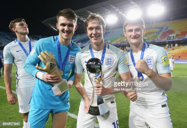 Freddie Woodman Kieran Dowell and Callum Connolly of England celebrate victory with the trophy after the FIFA U20 World Cup Korea Republic 2017 Final...