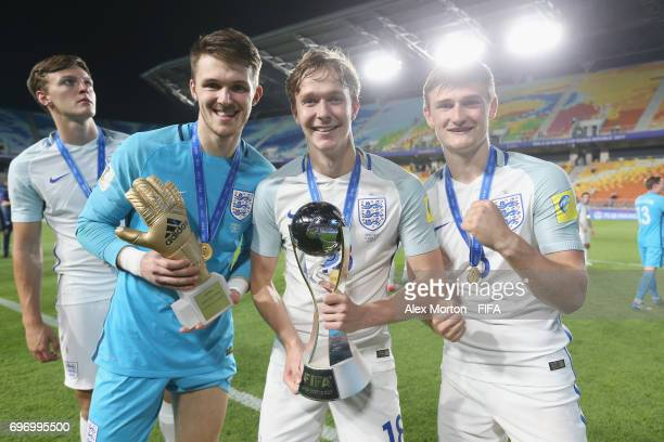 Freddie Woodman Kieran Dowell and Callum Connolly of England celebrate with the trophy after the FIFA U20 World Cup Korea Republic 2017 Final match...