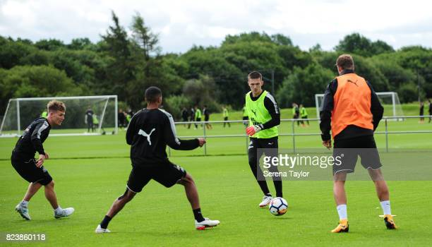 Freddie Woodman passes the ball during the Newcastle United Training session at the Newcastle United Training ground on July 28 in Newcastle upon...