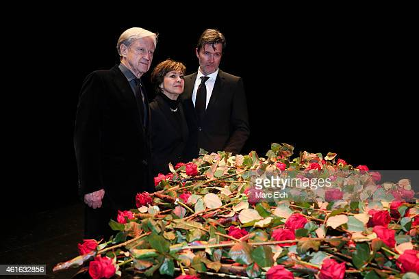 Freddy Burger manager of Udo Juergens Paola Felix and John Juergens son of Udo Juergens pose in front of a piano with roses at a memorial service for...
