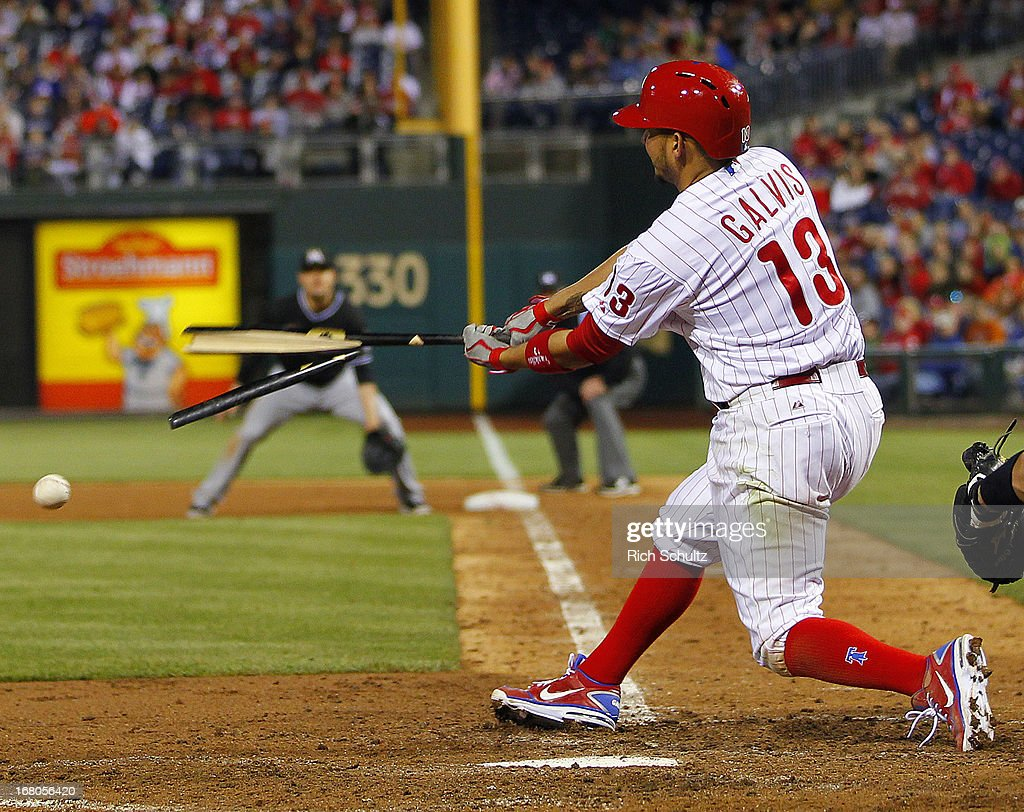 Freddy Galvis #13 of the Philadelphia Phillies breaks his bat against the Miami Marlins during the ninth inning in a MLB baseball game on May 4, 2013 at Citizens Bank Park in Philadelphia, Pennsylvania. The Marlins defeated the Phillies 2-0.