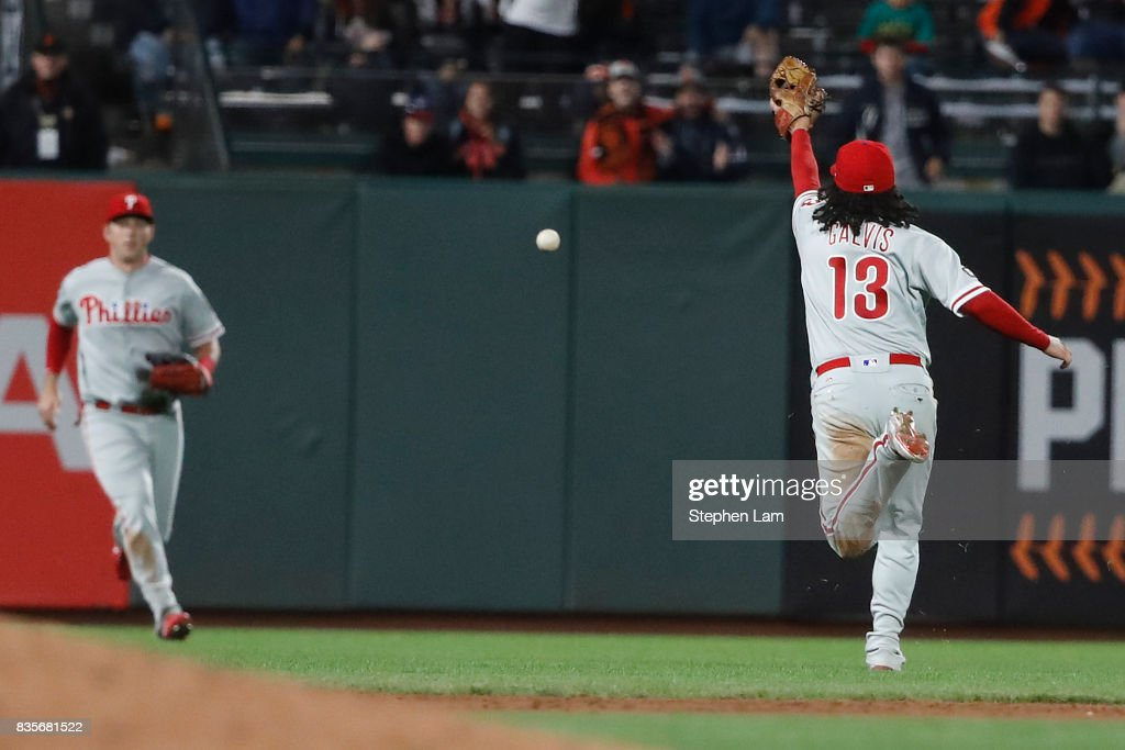 Freddy Galvis #13 of the Philadelphia Phillies couldn't catch a fly ball during the ninth inning against the San Francisco Giants at AT&T Park on August 19, 2017 in San Francisco, California. The Phillies defeated the Giants 12-9.