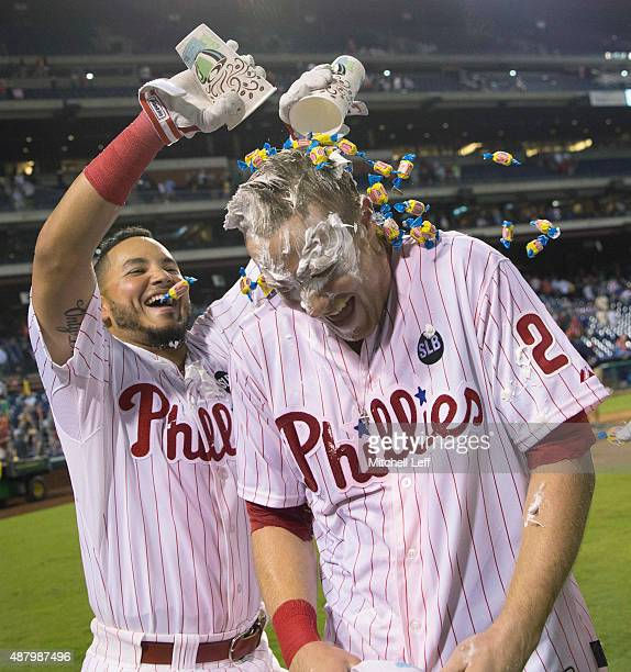 Freddy Galvis of the Philadelphia Phillies dumps bubble gum on Cody Asche after Asche hit a walkoff tworun home run in the bottom of the ninth inning...