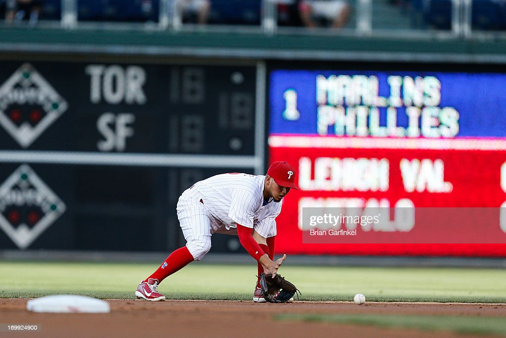 Freddy Galvis #13 of the Philadelphia Phillies fields the ball in the first inning of the game against the Miami Marlins at Citizens Bank Park on June 4, 2013 in Philadelphia, Pennsylvania.