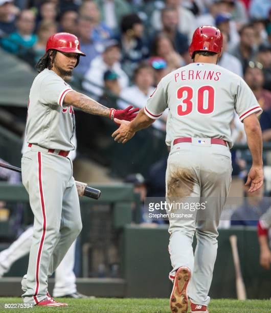 Freddy Galvis of the Philadelphia Phillies greets Cameron Perkins of the Philadelphia Phillies after Perkins scored on a sacrifice fly by Daniel Nava...