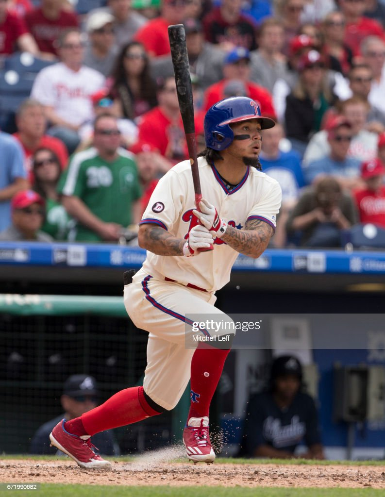 Freddy Galvis #13 of the Philadelphia Phillies hits an RBI single in the bottom of the seventh inning against the Atlanta Braves at Citizens Bank Park on April 23, 2017 in Philadelphia, Pennsylvania. The Phillies defeated the Braves 5-2.