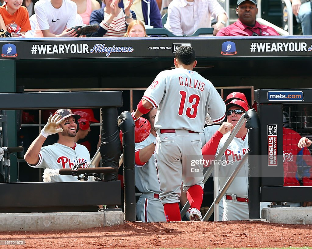 Freddy Galvis #13 of the Philadelphia Phillies is congratulated after his solo home run in the fifth inning against the New York Mets on April 28, 2013 at Citi Field in the Flushing neighborhood of the Queens borough of New York City.